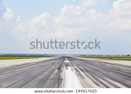 Airport - Striped line on the runway. - stock photo