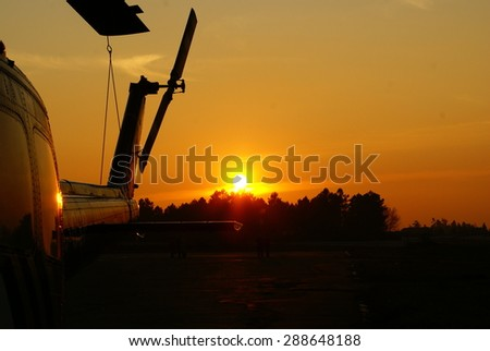 Airport Sunset Helicopter - stock photo