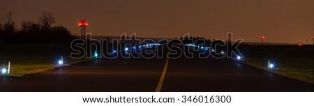 airport tarmac in the night panoramic view - stock photo