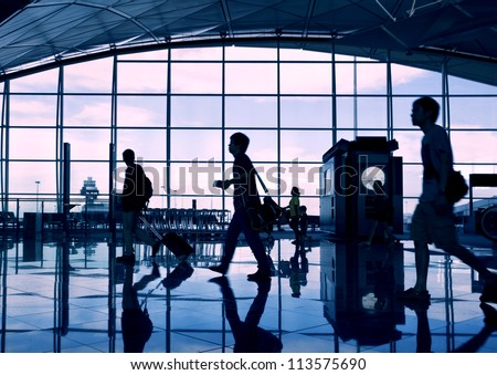 Airport terminal hall. Walking travelers
