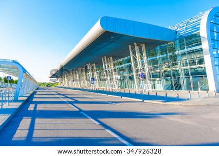 Airport terminal outside, flight departure gate and airport parking at sunny morning - stock photo