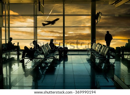 Airport terminal ,passenger wait for transportation with silhouette concept. - stock photo