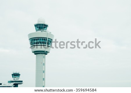 airport traffic control tower with copyspace - stock photo