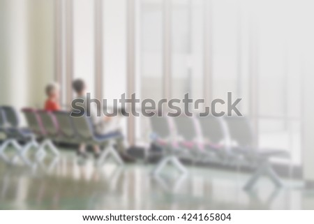 Airport waiting area with rows seats. Background for topics of travel and business. - stock photo