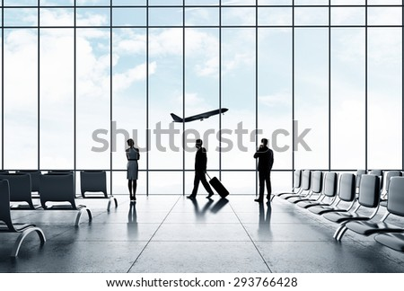 airport with people and airliner in sky - stock photo