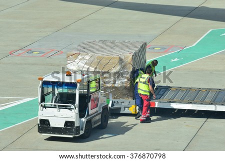 Airport workers loading freight onto a long haul Aircraft at London Gatwick - stock photo