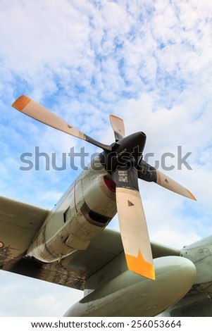 Airscrew engine of airplane from low angle, military aircraft