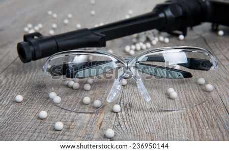 airsoft gun with glasses and lot of bullets - stock photo
