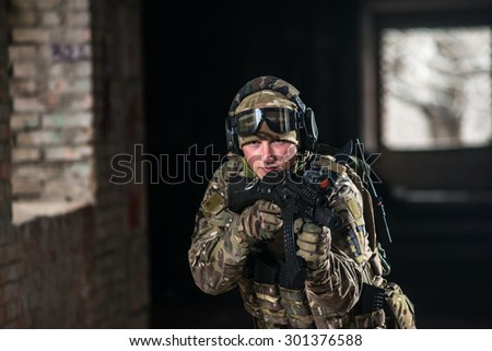 airsoft soldier with a rifle playing strikeball