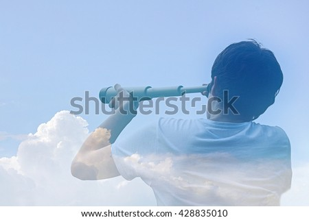 airy-fairy budding business man looking through a telescope in the clouds / in the clouds of hope - stock photo