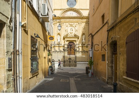 AIX EN PROVENCE,FRANCE-AUGUST 9,2016:People strolling down the typical streets of Aix-en-Provence during a summer day.