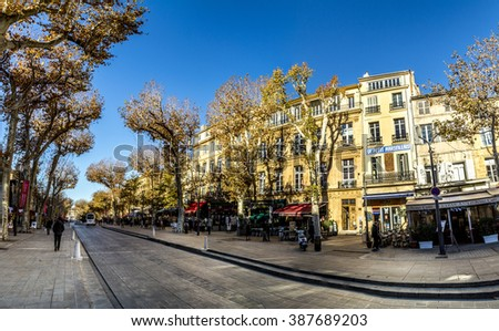 AIX EN PROVENCE, FRANCE - DEC 10, 2015: scenic street cours mirabeau in morning light in Aix en Provence, France. It is the most eloegant street in Aix.