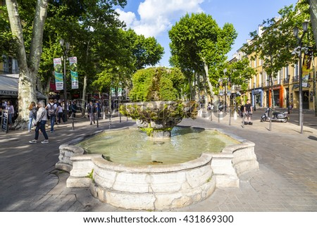 AIX EN PROVENCE, FRANCE - JUNE 3, 2016: people at cours Mirabeau at  nine cannon fontain in Aix en Provence, The sculptures are not visible because of the moss vegetation.
