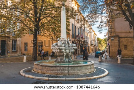 AIX-EN-PROVENCE, FRANCE - OCTOBER 9, 2009: Fountain of Four Dolphins or Fontaine des Quatre-Dauphins, symbol of the Mazarin Quarter, was built in 1667 and was originally called Fontaine Saint-Michel