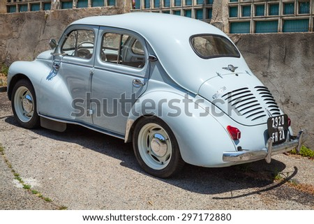 Ajaccio, France - July 6, 2015: Light blue Renault 4CV old-timer economy car stands parked on a roadside in French town, rear view