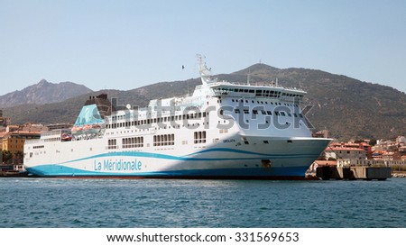 Ajaccio, France - June 30, 2015: White Girolata ferry ship stands moored in Ajaccio port