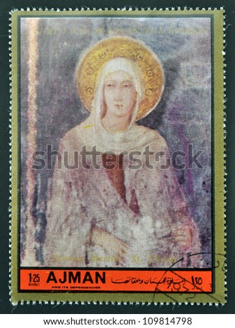 AJMAN - CIRCA 1972: A stamp printed in Ajman  Christmas collection, peace in the world, shows St. Chiara painted by Simone Martini , circa 1972