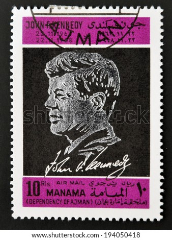 AJMAN - CIRCA 1970: A stamp printed in Ajman shows John F. Kennedy, circa 1970  - stock photo