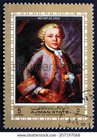 AJMAN - CIRCA 1972: a stamp printed in the Ajman shows Wolfgang Amadeus Mozart as Child, Austrian Composer, circa 1972 - stock photo