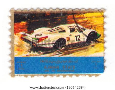 AJMAN - CIRCA 1973: stamp printed by Ajman state, shows old car, circa 1973 - stock photo