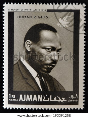 AJMAN - CIRCA 1974: Stamp printed in Ajman in memory of Martin Luther King, Human Rights, circa 1974  - stock photo