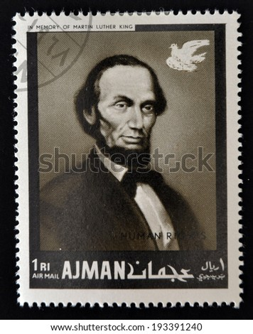 AJMAN - CIRCA 1974: Stamp printed in Ajman in memory of Martin Luther King, Human Rights, shows Lincoln, circa 1974  - stock photo