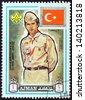 """AJMAN EMIRATE - CIRCA 1971: A stamp printed in United Arab Emirates from the """"13th World Boy Scout Jamboree - Japan"""" issue shows boy scout from Turkey, circa 1971. - stock photo"""