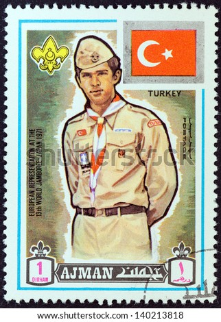 "AJMAN EMIRATE - CIRCA 1971: A stamp printed in United Arab Emirates from the ""13th World Boy Scout Jamboree - Japan"" issue shows boy scout from Turkey, circa 1971. - stock photo"
