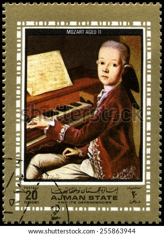AJMAN STATE - CIRCA 1972: A used postage stamp from Ajman State, depicting a portrait of famous Composer Wolfgang Amadeus Mozart as a child, circa 1972. - stock photo