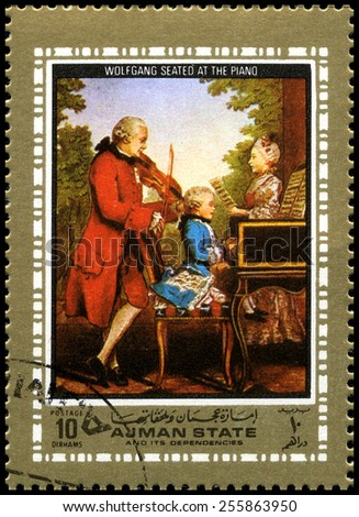 AJMAN STATE - CIRCA 1972: A used postage stamp from Ajman State, depicting a portrait of famous composer Wolfgang Amadeus seated at the Piano as a child, circa 1972. - stock photo
