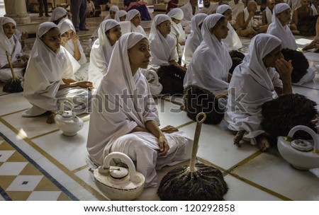AJMER, INDIA - OCTOBER 26: An unidentified group of Digamber Jain nuns, sadhvis, attend a religious ceremony at the Jain temple during Caturmas on October 26, 2011 in Ajmer, Rajasthan, India. - stock photo