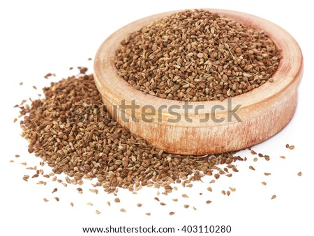 Ajwain seeds in a wooden bowl - stock photo
