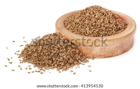 Ajwain seeds in a wooden bowl over white background - stock photo