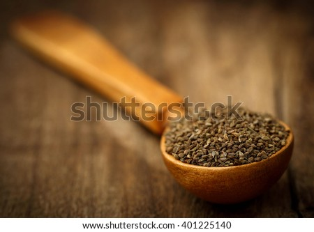 Ajwain seeds in a wooden spoon - stock photo