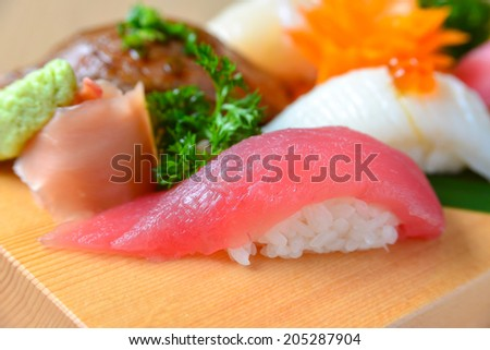 Akami Sushi (Makuro) on wooden plate decoration - stock photo