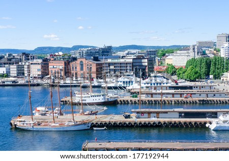 Aker Brygge pier at downtown Oslo, Norway - stock photo