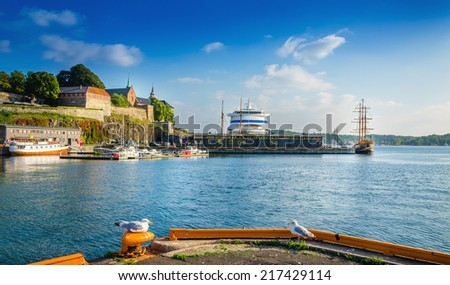 Akershus and Oslo fjord harbor at sunset, Oslo, Norway - stock photo