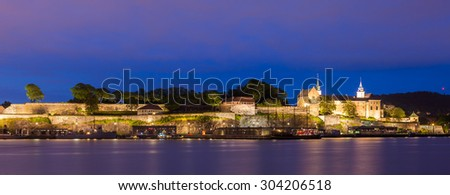 Akershus fortress and castle panorama at night in Oslo, Norway.
