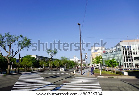 Akita, Japan - May 17, 2017. People walking on street at sunny day in Akita, Japan. Akita is a large prefecture at the Sea of Japan coast in the northern Tohoku Region.