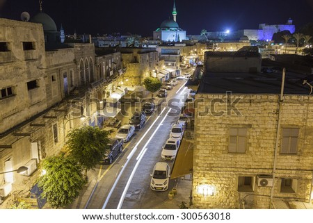 AKKO, ISRAEL - OCTOBER 22, 2014: Streets of ancient city of Akko at night. The place changed very little in several hundreds of years. - stock photo