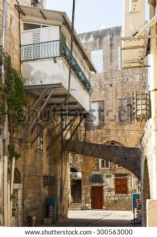 AKKO, ISRAEL - OCTOBER 23, 2014: Streets of ancient city of Akko in the morning. The place changed very little in several hundreds of years.