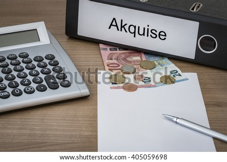 Akquise (German acquisition) written on a binder on a desk with euro money calculator blank sheet and pen - stock photo