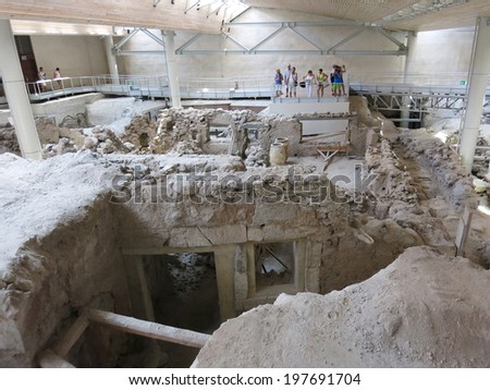 AKROTIRI, GREECE - JUN 29: Excavation archaeological site of Akrotiri on Jun 29,2013 in Santorini, Greece. Akrotiri is a Minoan Bronze Age settlement on the volcanic Greek island of Santorini. - stock photo