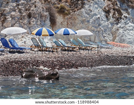 Akrotiri, Santorini, Greece. Sunbeds at the black Beach in Santorini.