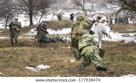 AKSAY, RUSSIA-FEBRUARY 16- Reconstruction of hostilities within the 71-year anniversary of the liberation  of Rostov-on-Don from Nazi invaders on february 16,2014  in Aksay.Military journalist