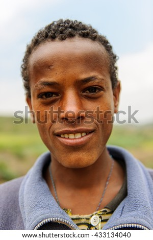 AKSUM, ETHIOPIA - SEP 24, 2011: Portrait of an unidentified Ethiopian boy in Ethiopia, Sep.24, 2011. People in Ethiopia suffer of poverty due to the unstable situation - stock photo