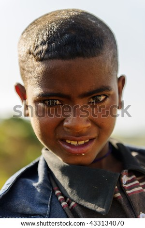 AKSUM, ETHIOPIA - SEP 24, 2011: Portrait of an unidentified Ethiopian boy in Ethiopia, Sep.24, 2011. People in Ethiopia suffer of poverty due to the unstable situation