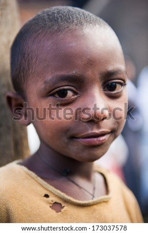 AKSUM, ETHIOPIA - SEP 27, 2011: Portrait of an unidentified Ethiopian cute girl in old clothes in Ethiopia, Sep.27, 2011. Children in Ethiopia suffer of poverty due to the unstable situation