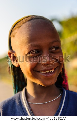 AKSUM, ETHIOPIA - SEP 30, 2011: Portrait of an unidentified Ethiopian cute little boy in Ethiopia, Sep.30, 2011. Children in Ethiopia suffer of poverty due to the unstable situation