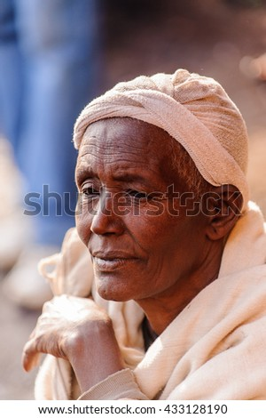 AKSUM, ETHIOPIA - SEP 27, 2011: Portrait of an unidentified Ethiopian woman in white tissue in Ethiopia, Sep.27, 2011. People in Ethiopia suffer of poverty due to the unstable situation